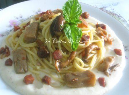 Spaghetti con funghi misti spek e fonduta