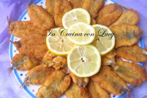 Cotolette di alici impanate aromatizzate al curry e limone